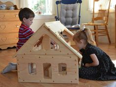 This beautiful Maine dollhouse is big and open, so multiple children can play with it together.