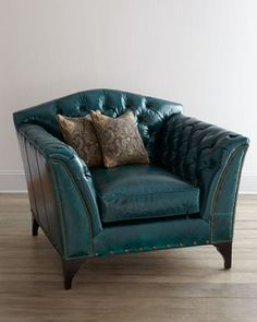 """Old Hickory Tannery """"Montana"""" Chair via Neiman Marcus, $3,499. Deep-seated armchair brings together the rustic and refined in an unexpected shade of turquoise leather."""