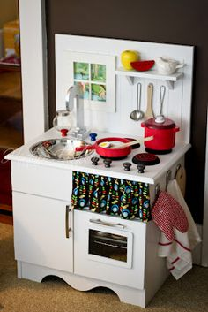 Fun kids play kitchen made from an old nightstand!