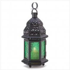 Green Glass Lantern Centerpieces - Like something out of the Slytherin Common Room.