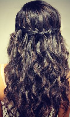 Romantic Dark Waves with Braid Circlet - waterfall plait This fresh, new way of creating defined, loose waves, is great for boosting volume and making hair look twice its normal thickness! From one temple, a braid is woven along the side and around the head in a pretty, horizontal circlet. From the smooth crown, sections are[Read the Rest]