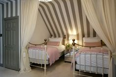 Room with sloping ceilings, love this idea!