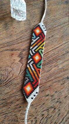Sacred Ceremony Amulets, Hand Loomed, Shamanic Amulets, Ayahuasca Inspired, Protection Amulet Beaded arm band originally from Colombian tribes that work. Bead Loom Bracelets, Beaded Bracelet Patterns, Bead Loom Patterns, Beading Patterns, Bead Jewellery, Beaded Jewelry, Seed Bead Necklace, Loom Beading, Bead Weaving