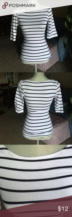 3/4 sleeve shirt White with black stripes 3/4 sleeve shirt. 60% cotton, 35% polyester, 5% spandex. Tops
