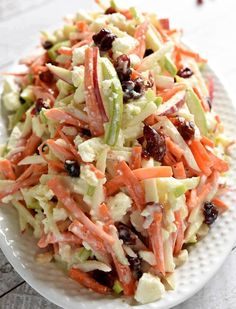With crunchy carrots, sweet and tart apples, dried cranberries, salty feta cheese, and a creamy dressing, this Carrot Apple Slaw is a refreshingly sweet and savory salad for summer! Ingredients 1 large sweet red apple 1 large tart green apple 1 tablespoon freshly-squeezed lemon juice 10 ounces raw m…