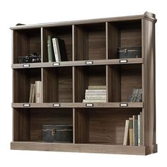 Bring rustic elegance to your library or den with this charming bookcase, showcasing a salt oak finish and label hardware.   Product: