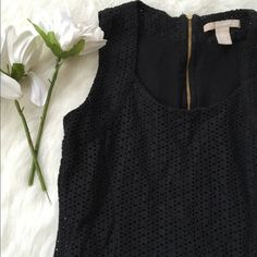 Black Banana Republic Eyelet Blouse Never worn! Cute zip up back. Black eyelet pattern that's not see through at all. NO TRADES PLEASE Banana Republic Tops Blouses