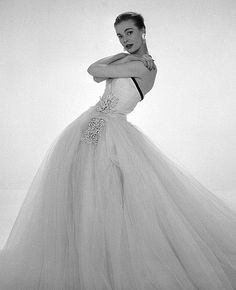 Susan Abraham in John Cavanagh's strapless tulle evening gown, photo by John French, Spring 1954