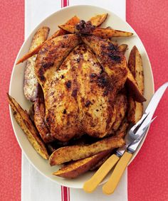 Honey-Basted+Chicken+with+Chile-Roasted+Potatoes - GoodHousekeeping.com