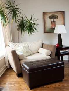 Budget Living Room Makeovers Under $100 via iVillage, including our faux leather storage ottoman