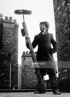 91 year-old chimney sweep Titch Cox with his rods and brushes on a rooftop in London on 30th December 1969. (Photo by Popperfoto/Getty Images).
