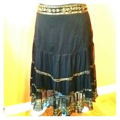Black Gypsy Skirt with Gold Sequin Details Fully lined Guess skirt with side zipper closure. The fabric is flowy with beautiful gold embroidery and sequins throughout. In excellent condition. Size small. No stretch. Guess Skirts A-Line or Full