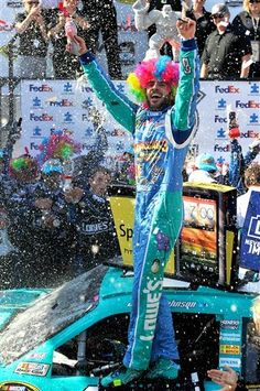 Jimmie Johnson celebrates winning the NASCAR Sprint Cup Series FedEx 400 auto race at Dover International Speedway, Sunday, June 3, 2012