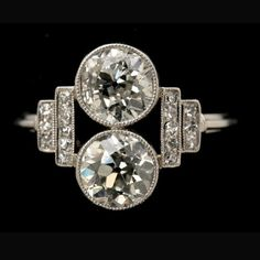ART DECO DIAMOND, PLATINUM RING. Featuring 2 old European-cut diamonds weighing approx. 1.15 ct., and 1.00 ct., accented by 16 single-cut diamonds weighing a total of approx. 0.25 ct., bezel and bead set in a platinum mounting. Size 6 1/2, 2.40 dwts (hva)