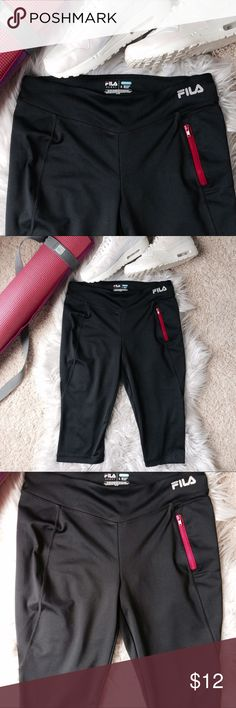Fila Running Crops Performance Running leggings/pants by Fila. These have booty contouring seams and a hot pink zipper pocket for your phone  EUC! Perfect for the avid runner. They'd also work well for yoga & even hot yoga due to their wicking fabric. Tags: Athleta, lululemon, Adidas, Nike, Alo yoga, Beyond yoga, capris Fila Pants Leggings