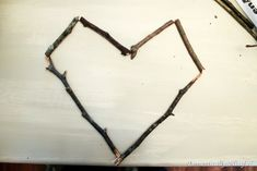 Don't you just love fun free cute crafts? I had some sticks left over from my DIY Sparkling Sliver Branches so instead of just throwing them Twig Crafts, Heart Crafts, Cute Crafts, Wooden Hearts, Valentine Decorations, Heart Art, Heart Shapes, Projects To Try, Hair Accessories