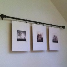 Hang pictures from a curtain rod with curtain hooks, would have been cool to hang them at different levels with twine as well