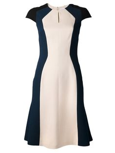 For the occasion, Her Majesty recycled the Carolina Herrera colour-block dress, which she premiered at the National Culture Awards in February.  The dress is rendered in wool crepe and features a key-hole neckline. The strategic black, navy and ivory colorblock pattern gives the illusion of a slim hourglass figure.