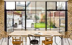 Crittal doors and exposed brickwork with a contemporary kitchen Crittal Doors, Glass Extension, Extension Ideas, Side Extension, Edwardian House, Victorian Terrace, Victorian Houses, Open Plan Kitchen Living Room, London House