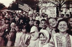 Ft. Worth school children laughing and smiling, as the wait for John F. Kennedy to drive by