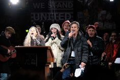 "From left in foreground, Natalie Merchant, Cher and Mark Ruffalo singing during the ""We Stand United"" rally in New York in January. (Message to President-elect Trump and Congress that New York will protect the rights of people and the environment.)"