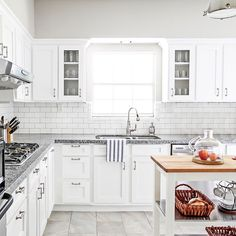 I'm sharing the scoop on our refaced kitchen cabinets on the blog today. If money is an issue (as I know it is for most of us!), then you'll want all the details on this makeover option. #paxkitchenreno #remodel #whitekitchen