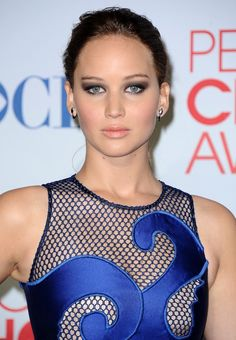 "Jennifer Lawrence, winner People's Choice Awards 2013 ""Favorite Movie Actress"" wearing Lancome Mascara"