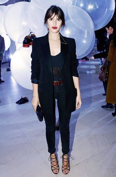Parisian It Girl Jeanne Damas dresses up casual jeans and an oversized blazer with strappy heels and a bright red lip