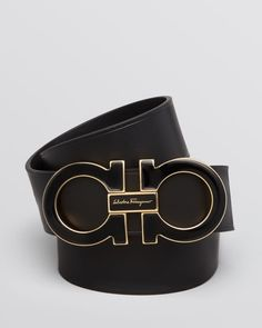 "Salvatore Ferragamo's iconic Gancini buckle is rendered in polished enamel on this ultra-luxe leather belt. | Leather | Made in Italy | 1.75""W 