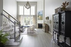 Looking for Living Space and Living Room ideas? Browse Living Space and Living Room images for decor, layout, furniture, and storage inspiration from HGTV. Luxury Vinyl Tile, Luxury Vinyl Plank, Waterproof Vinyl Plank Flooring, Vinyl Flooring Kitchen, Types Of Flooring, Coastal Farmhouse, House And Home Magazine, Family Room, Hgtv