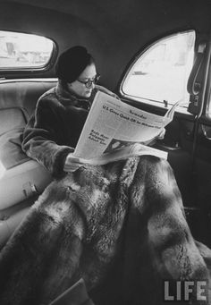 Newsday publisher Alicia Patterson reading her newspaper in backseat of her chauffeur-driven limousine, with large fur lap robe covering her legs, en route to LI office from NYC. Long Island, NY (1958). LIFE. Great-granddaughter of Joseph Medill,...