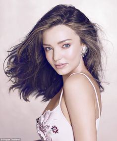Natural beauty: Miranda Kerr showed her feminine side with flirty dresses and windblown hair in a new shoot for Vogue Thailand's December issue