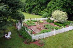 Potager Garden at Bumble Bee Blog.....love the idea of a picket fence around garden.