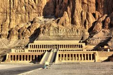 The Mortuary Temple of Hatshepsut, was inspired by Mentuhotep's temple with it's terrace with ramps that were once surrounded by gardens leading up to a main sanctuary that is hollowed into a cliff. Its is one of several mortuary tombs of Deir el-Bahari located on the west bank of the Nile.
