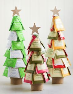 Christmas Tea Trees~ Hot glue tea bags to styrofoam cone mounted to round paper box as trunk. Filled with rice for weight to keep tree from falling over. Add honey bear with red ribbon and you have a great gift.