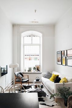 Small Scandinavian living room with pops of yellow