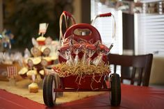 Little Red Wagon Cake Pops...I love that they're displaying them on the back of this little bike!