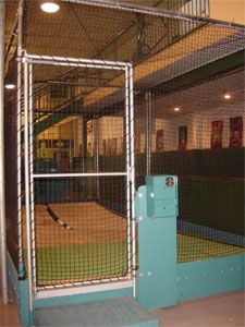 Nice indoor cage at d2 baseball academy d2 baseball for Design indoor baseball facility