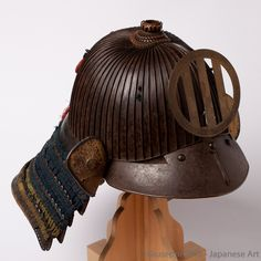 "A rare and old ""modern"" Samurai helmet kabuto. The tenkokuzan shape of this bachi, lower in the center and slightly higher on the back, is somehow more round than usual and shows a nicely round mabizashi (visor). The height of the suji (ridges) is typical of older Samurai helmets."