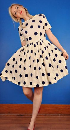 Polka dots. This would turn heads.... I'd wear a bright colored blazer with it. The dress could have even been a nice coral or salmon color