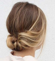 Short on time? Go from blah to beautiful in only a few minutes with this braided headband updo. Headbands can accessorize and add a unique pop to an outfit—especially if you're repeating a dress you've already worn before. Get Step-by-Step Instructions