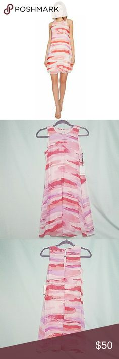 NWT Calvin Klein Watercolor Trapeze Sheer Dress New with tags!  Beautiful pink and purple pastels. Keyhole back. Reasonable offers accepted! Bundle 2+ items for 20% off! 💕 Calvin Klein Dresses