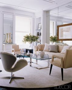 In Mendel's Manhattan living room, designed with Alan Tanksley, a vintage Swan chair by Arne Jacobsen upholstered in mink takes center stage.  House Tour Gilles Mendel - ELLE DECOR