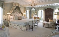 A master bedroom with coffered ceiling, renovated spa-quality bath with sensational mosaic reliefs, granite-topped vanities, walk-in closet and a fitted dressing room