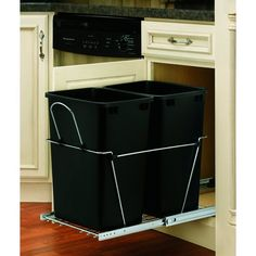 pull out cans from lowe's - if it fits in the cabinet next to my sink I totally want these!