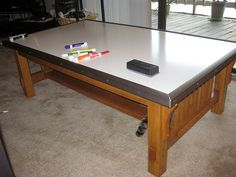 Whiteboard-topped coffee table. I like it. It's a great idea for the kids, too.