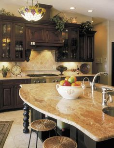 Gorgeous colors in this kitchen. love the dark finish with the golden granite. Def a contender for the house!