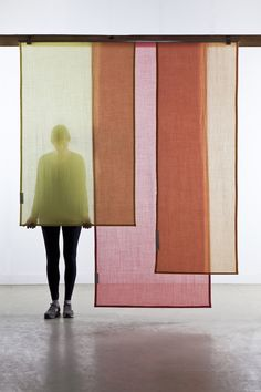 Tinctorial Textiles is a new step in the research on natural pigment. Having mainly experimented with vegetable dyes in the past it was a new step to explore the area of plant dyes. 13 curtain panels executed in semi translucent wool overlap with other eachother to create colour blends between the panels.