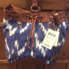 """NWT Bali Hai Sling Bag in Surf Blue NWT, perfect condition. Fabric with PU leather trim. 1 zip pocket. 2 slip pockets. Magnetic snap closure, with drawstring top. One strap in the middle for over the shoulder wear. 8h X 8w X 9d. 13"""" drop. No lowball or public offers p,ease. No trades. Lucky Brand Bags Shoulder Bags"""