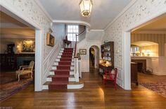 Traditional Staircase with Hardwood floors, Wainscoting, interior wallpaper, Crown molding, High ceiling, flush light